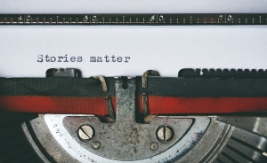 Close up of typewriter ribbon and the typed words Stories Matter