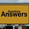 Questions and Answers written in large black lettering on a yellow sign.