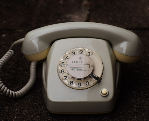 Old fashioned pale grey, beige coloured telephone